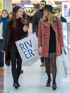 Winter warmers: Lucy, 25, looked chic in a plaid mini skirt and roll-neck jumper, while Steph, 29, went for a bright red plaid jacket over a tiny LBD and a funky hat