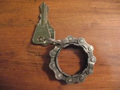 This is the ideal gift for anyone cyclist or any person who loves living a green lifestyle!  Made from a recycled 11 tooth bicycle gear and chain. This keychain measures approximately 2 in diameter and is very solid. Since this is produced from recycled products it does so signs of wear and use.
