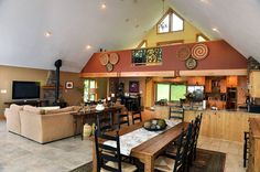 Open dining room, kitchen, living room. High ceiling with recessed lighting, tile floor.