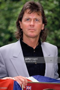 English singer John Wetton of Asia attends a photocall for the release of the gold 'Earthquake Album' by the Armenian earthquake appeal 'Rock Aid Armenia' in 1990 ca. in London, England. Numerous vocalists collaborated on a recording of the Deep Purple hit 'Smoke on the Water', in aid of the 1988 Spitak earthquake victims.