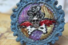 Skull and wings original mixed media , acrylic, polymer clay, skull pendant, metallic textured, purple, blue, gold