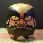 Daruma doll, also known as a Dharma doll, is a hollow, round, Japanese traditional doll modeled after Bodhidharma, the founder of the Zen sect of Buddhism. These dolls, though typically red and depicting a bearded man (Dharma), vary greatly in color and design depending on region and artist.