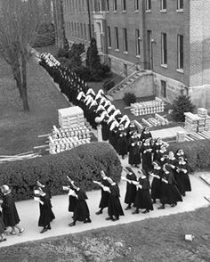 Postulants, novices and professed sisters in procession during the dedication ceremony of Lourdes Hall, Dayton, Ohio, 1954