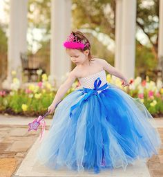 Something Blue flower girl tutu dress in various shades of blue, finished with a blue sash on Etsy, $55.00