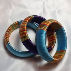 Set of 3 Thread Wrapped Bangles NWOT Bright multi-colored silk thread wrapped bangles. Wear individually or stacked. Set of NWOT Jewelry Silk Thread Earrings Designs, Silk Thread Bangles Design, Silk Bangles, Diy Fabric Jewellery, Thread Jewellery, Funky Jewelry, Thread Chains, Thread Bracelets, Gold Silk Saree