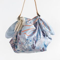 Use your furoshiki as a simple shoulder bag with one of our handmade straps — ideal for lightweight travels. Arizona Sunrise, Japanese Wrapping, You Look Beautiful, Camping Car, Metal Buckles, Tan Leather, Bucket Bag, Shoulder Bag, This Or That Questions