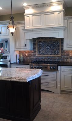 Painted Finish With Glaze Inset Cabinets.