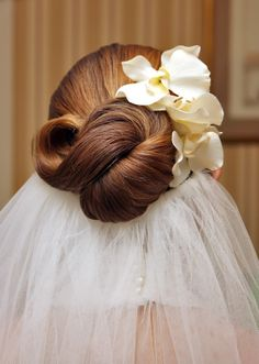 Bridal hairstyle from Out of the Ordinary - this looks like an infinity knot in her hair and I love this style!