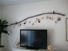 Driftwood and shells - lovely idea for wall outside on a deck/verandah