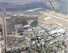 Aerial view of the NASA Ames Research Center, Mountain View, California. The large flaired rectangular structure in the center of the photo is the 80 x 120 Foot Full Scale Wind Tunnel. Adjacent to it is the 40 x 80 Foot Full Scale Wind Tunnel which has been designated a National Historic Landmark.