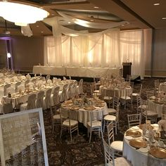 Chandelier drapes incorporated in Twinkle Light Backdrop  #lachefs #lachefsdecor #twinklelight #twinklelightbackdrop #backdrop #headtable #guesttables #roundsandrectangles #chiavarichairs #goldchargers #ceilingdrapes #chandelierdrapes #mirrorseatingchart #centrepieces #ivory #gold #champagne