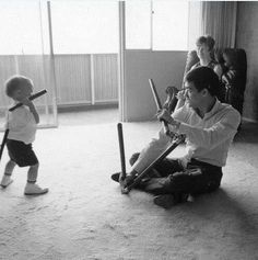 Candid shot of Bruce with the three-sectioned-staff and baby Brandon with the nunchaku.