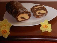 Čokoladni rolat sa orasima je fina poslastica sa zanosnim ukusom oraha i čokolade. Jednostavno se priprema i čest je ukras na našoj trpezi.