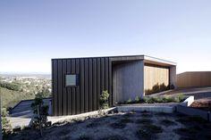 Gallery of Ophir / Architect's Creative - 1: black zinc metal siding; pre-cast concrete panels