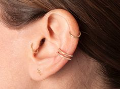 """BRVTVS    Large two-bar ear cuff ($170): http://www.brvtvs.com/product/large-two-bar-cuff    A bit tougher version of our single cuff. This size is best suited to wear on middle portion of your ear to mimic a """"conch"""" piercing."""