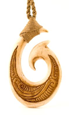 The maori hei matau is a symbol for safe passage over water, and something I wouldn't mind adding to my dry bag.