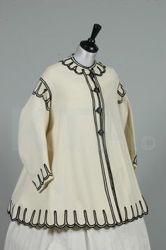 ivory wool flannel paletot, circa 1867, with black soutache trim