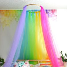 DIY Rainbow Canopy - love this idea for a unicorn birthday party tent or behind the party table