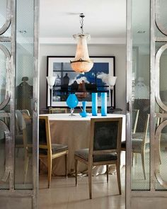 eugenia soler roig dining room--carved louis chairs, chandelier, skirted round table, turquoise, deco industrial doors