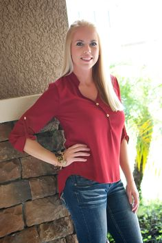 This burgundy top is a great addition to your fall wardrobe! Great fit, high-low style, gold buttons, and adorable fold-up buckle sleeves make this shirt simply perfect!
