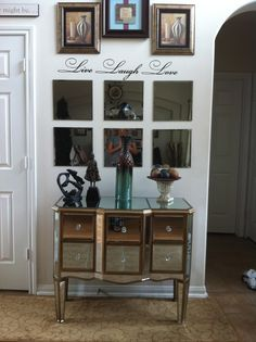 mirrored console tables are so eye-catching! great buy cause of broken leg.