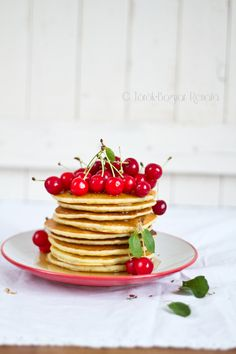 gluten-free ginger pancake with maple syrup and cherries