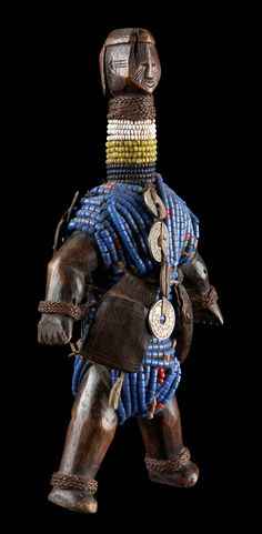 Africa | Fertility doll from the Namji people of Cameroon | Wood, glass beads, metal and leather amulets.
