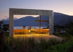 Skewed concrete chapel that balances over a mountainside in El Salvador.