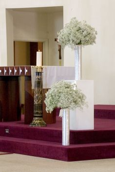 For the Ceremony we used some of the centerpieces on white straight block stands.