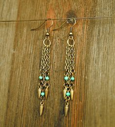 Brass & Turquoise Drop Earrings by Crow Jane Jewelry on Scoutmob Shoppe. An elegant pair of earrings featuring dangly pendants made up of tiny turquoise beads and small raw brass studs.