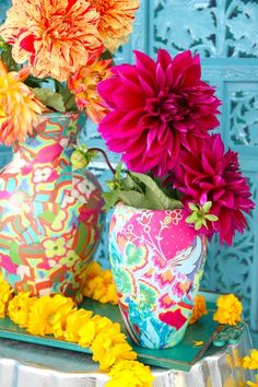 colorful pattern on vases + intricate blue backdrop