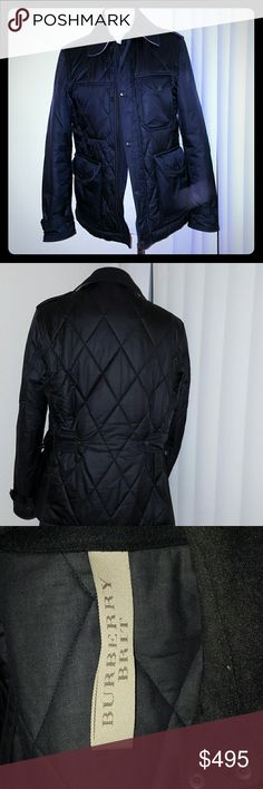 Burberry Brit  Quilted Mens Jacket Burberry Quilted men jacket. Nylon and cotton. Wool collar with signature nova check. Stand collar with throat latch. Epaulets on shoulder.  Button front /zip. Worn gently. Fits size 38 to 40. Burberry Jackets & Coats Lightweight & Shirt Jackets