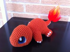 Eyes and nails are needle felted. Tail flame was made by brushing out yarn.