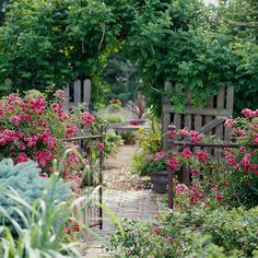Build a Boundary- A simple wire gate decorated with roses creates a pretty entrance -- and offers a clear barrier -- without obstructing the view. The entrance still feels welcoming, despite the bigger gate and arbor behind.