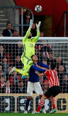 Manchester United's Argentinian goalkeeper Sergio Romero claims the ball during the English Premier League football match between Southampton and...