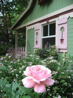 Green wooden Cottage with rose garden and wood shutters with potted plant planter cut out; Upcycle, Recycle, Salvage, diy, thrift, flea, repurpose!  For vintage ideas and goods shop at Estate ReSale & ReDesign, Bonita Springs, FL