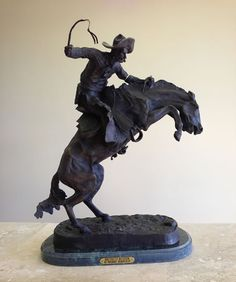 Bronco Buster by Frederic Remington Cowboy Sculpture in Bronze Available at AllSculptures.com