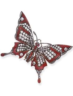 AN ANTIQUE DIAMOND AND ENAMEL BUTTERFLY BROOCH