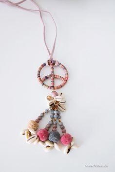 Chain with pompons and shells PEACE