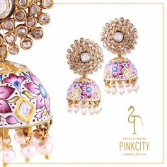 This Pinkcity earring with a detachable jhumka is crafted with pearl, rose diamonds and polki.