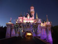 the castle at night in disneyland. even better with the fireworks show. my favorite place in the world.
