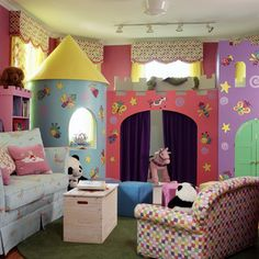 This fantasy playroom for two little girls includes a large castle playhouse containing a stage, dress up closet, puppet theater and tower sleeping loft.