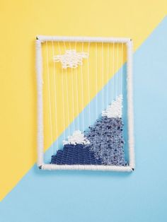 This wall hanging is too cute to pass up! Simple and charming, it's also a great way to use up any leftover yarn you may have hanging about.  Skill Level: Moderate  Time Required: More than 3 hours  Project Cost: $30