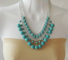 Beautiful layered necklace features of silver plated chain with dangling turquoise beads.  Necklace measures 18 plus extension chain.  A classic