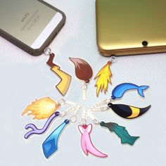 Give your favorite device a totally unique and an awesome accessory! These Eevee evolution (and Pikachu) charms are made from laser cut acrylic and will poke right into any headphone jack. Works well on phones, Nintendo DS, cameras and more! #Pokemon