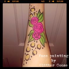 Hot pink roses with leopard print by Glitter Goose. Cool edgy rocker girl face painting ideas. paint body arm art.