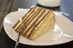 Esterhazy torte is a rich dessert consisting of chocolate buttercream sandwiched between four layers of sponge cake. Hungarian Desserts, Hungarian Recipes, Hungarian Food, Hungarian Cake, Austro Hungarian, Austrian Desserts, Slovak Recipes, Lithuanian Recipes, Austrian Recipes