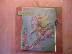 Made at a craft workshop - card opens to reveal a diagonal pocket on both sides into which a tag was placed.