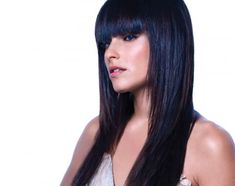 Songstress Nelly Furtado, who is a natural Latina beauty, goes for a blue sheen to her black hair