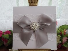 K0043 WHITE PEARLESCENT LACE WEDDING INVITATION SATIN BOW PEARL Available from www.vintagelaceweddingcards.co.uk